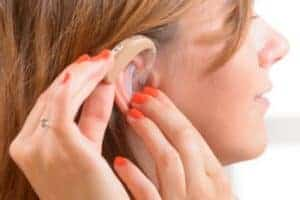 Setting up a hearing aid.