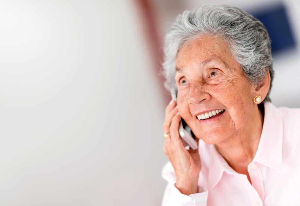 Portrait of a happy senior woman on the phone-1